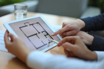 home builder showing floor plans to a potential home buyer